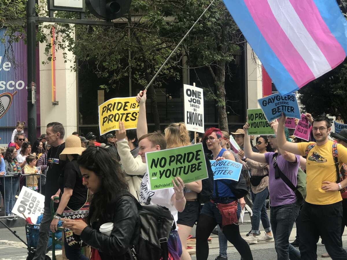 FILE - Google protestors are seen at San Francisco Pride on June 30, 2019. Activists expressed their frustration with the company's LGBTQ+ policy this month after the company decided that homophobic and racial slurs about a Vox journalist in a video posted by conservative commentator Steven Crowder did not violate YouTube's terms of service.