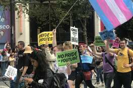 Google protestors are seen at Pride 2019 in San Francisco. Activists expressed their frustration with the company's LGBTQ+ policy this month after the company decided that homophobic and racial slurs about a Vox journalist in a video posted by conservative commentator Steven Crowder did not violate YouTube's terms of service.