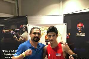 Emilio Garcia, right, won by split decision Saturday to defend his national title at the 2019 USA Boxing National Junior Olympics in Madison, Wisconsin. Garcia is pictured with his trainer and father Jose Luis Garcia.