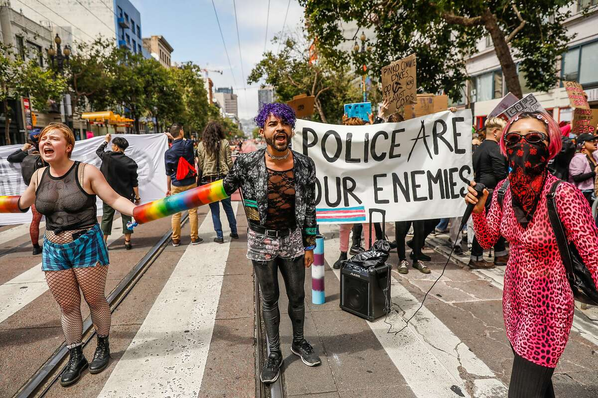 (l-r) Indigo Cochran and Zedgar Infiniti and others protested on Market Street in an attempt to shut down the annual Pride Parade in San Francisco, California, on Sunday, June 30, 2019. The group was anti-police and against the coorperations participating in the parade.