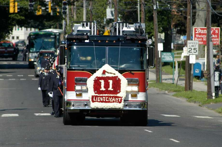 The funeral procession carrying the body of Bridgeport Firefighter Lt. Steven Velasquez leaves the Klein Memorial Auditorium Photo: Jeff Bustraan, Staff Photographer / Connecticut Post