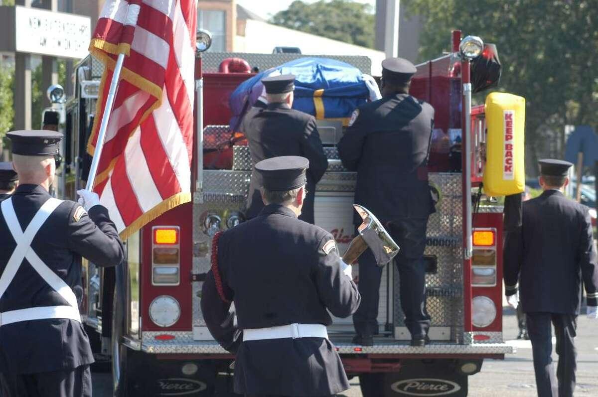The funeral procession carrying the body of Bridgeport Firefighter Lt. Steven Velasquez leaves the Klein Memorial Auditorium