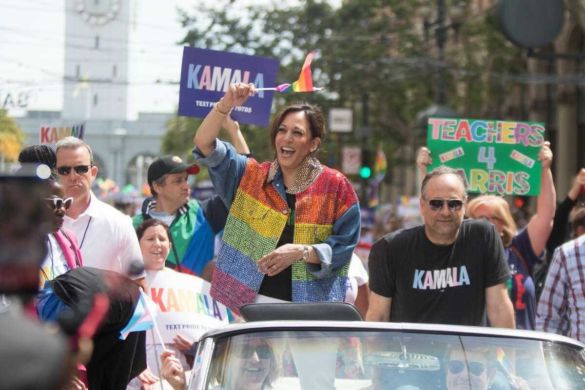 US Senator Kamala Harris waves a rainbow flag while taking part in the 2019 San Francisco Pride Parade on Market Street in San Francisco on June 30, 2019.