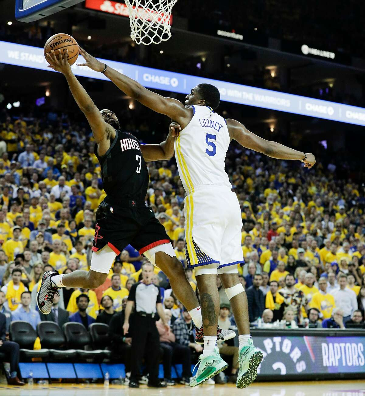 Golden State Warriors Kevon Looney blocks a Houston Rockets Chris Paul shot in the fourth quarter during game 5 of the Western Conference Semifinals between the Golden State Warriors and the Houston Rockets at Oracle Arena on Wednesday, May 8, 2019 in Oakland, Calif.