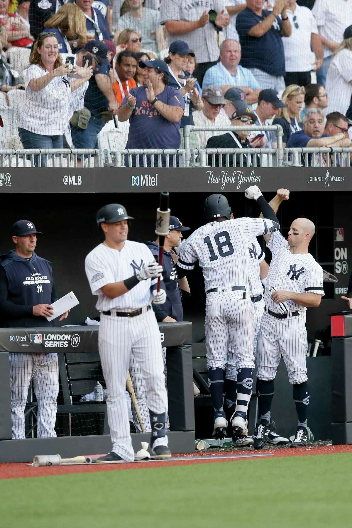 New York Yankees' Didi Gregorius (18) celebrates at the dugout after a home run against the Boston Red Sox during the sixth inning of a baseball game in London, Sunday, June 30, 2019. (AP Photo/Tim Ireland)