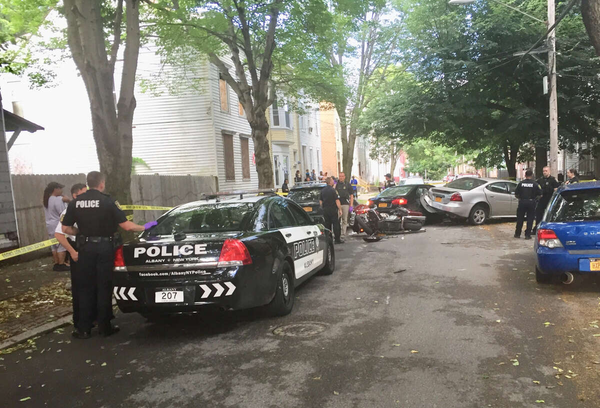 Albany police responded to a hit-and-run at 6:40 p.m. Sunday on First Street. The driver took off on foot and is still at large. He left behind two teenagers and two loaded handguns in the car.