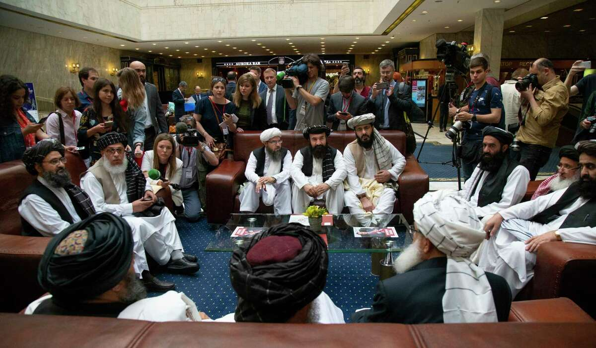 FILE - In this file photo taken on Tuesday, May 28, 2019, Mullah Abdul Ghani Baradar, the Taliban group's top political leader, left, Sher Mohammad Abbas Stanikzai, the Taliban's chief negotiator, second left, and other members of the Taliban delegation speak to reporters prior to their talks in Moscow, Russia. The seventh and latest round of peace talks between the U.S. and Taliban is