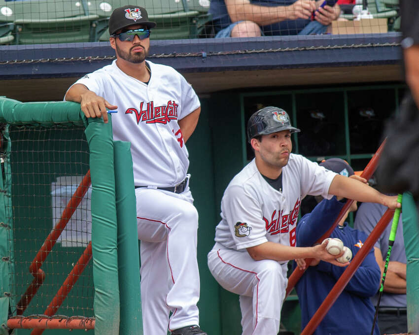 Tri-City ValleyCats manager Ozney Guillen and bat boy Charlie look on during a game against the Aberdeen IronBirds at the Joseph L. Bruno Stadium on Sunday, June 30, 2019 (Jim Franco/Special to the Times Union.)
