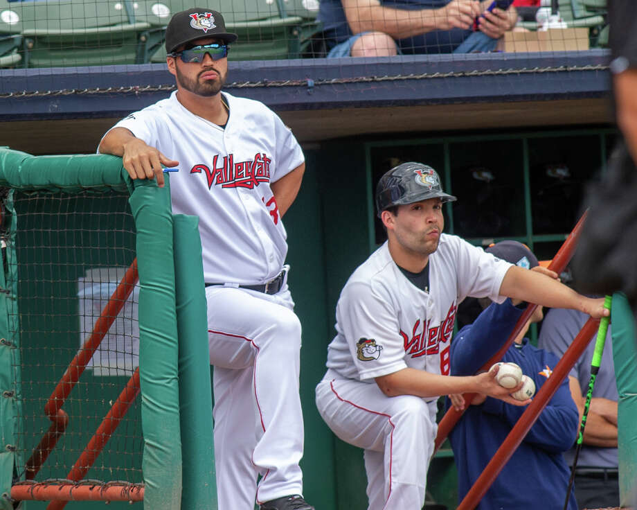 Tri-City ValleyCats manager Ozney Guillen and bat boy Charlie look on during a game against the Aberdeen IronBirds at the Joseph L. Bruno Stadium on Sunday, June 30, 2019 (Jim Franco/Special to the Times Union.) Photo: James Franco / 40047113A
