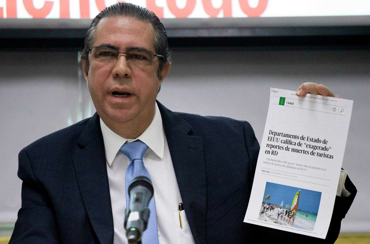 The Minister of Tourism of the Dominican Republic Francisco Javier García, holds a copy of an online article in a local paper saying the U.S. State Department considers recent reports on tourists' deaths to be exaggerated, at the Ministry of Tourism office in Santo Domingo, Dominican Republic, Friday, June 21, 2019. According to García the deaths of eight American tourists in the Dominican Republic this year are not part of a mysterious cluster but rather a medically and statistically normal phenomenon that has been irresponsibly lumped together by the U.S. media. (AP Photo/Tatiana Fernandez)