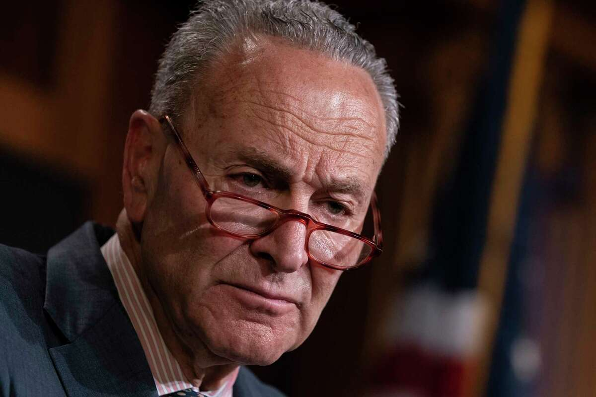 FILE - In this Tuesday, June 18, 2019 file photo, Senate Minority Leader Chuck Schumer, D-N.Y., talks to reporters at the Capitol in Washington. Schumer called on the U.S. government Sunday, June 30, to step up its efforts to investigate the deaths of Americans who traveled to the Dominican Republic and is asking the Bureau of Alcohol, Tobacco, Firearms and Explosives to get involved. (AP Photo/J. Scott Applewhite, File)