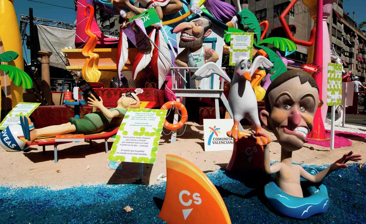 Satirical structures made of cardboard, portraying current events and personalities, are built in the streets of Alicante to eventually been burnt at midnight June 24, annually during Sant Joan festival.