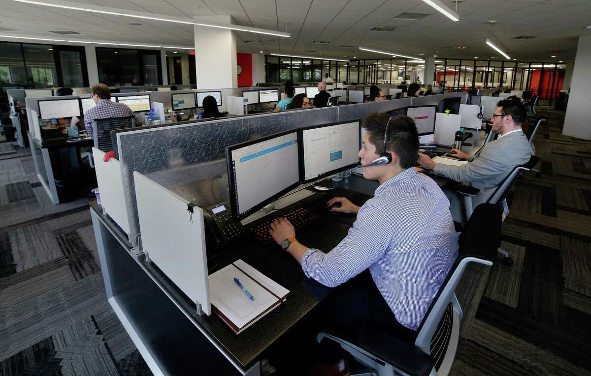 The cubicles may all be the same, but not the workers who occupy them. (Michael Wyke / For the Chronicle)