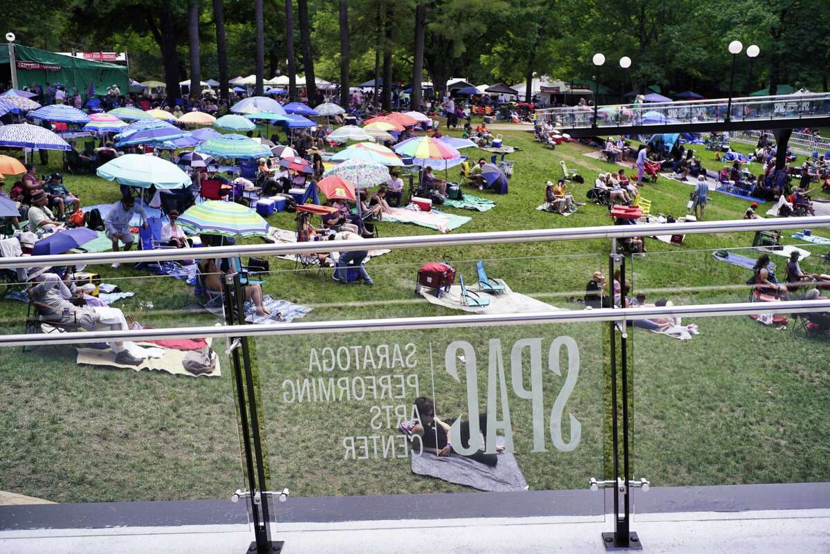 Fans listen to the music at the amphitheater stage as they sit on the lawn at the Freihofer?s Saratoga Jazz Festival at the Saratoga Performing Arts Center on Sunday, June 30, 2019, in Saratoga Springs, N.Y. (Paul Buckowski/Times Union)