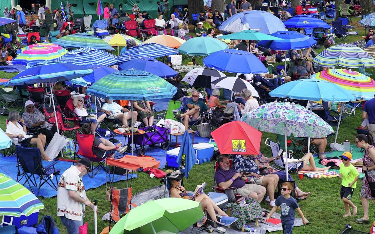 Umbrellas are used to create shade from the sun as fans listen to the music at the amphitheater stage as they sit on the lawn at the FreihoferOs Saratoga Jazz Festival at the Saratoga Performing Arts Center on Sunday, June 30, 2019, in Saratoga Springs, N.Y. (Paul Buckowski/Times Union)