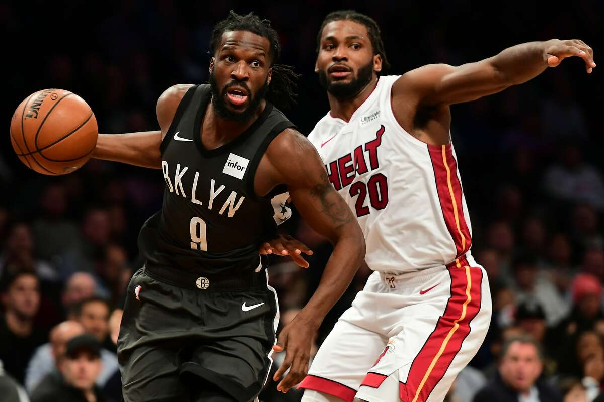 NEW YORK, NY - NOVEMBER 14: Justise Winslow #20 of the Miami Heat guards DeMarre Carroll #9 of the Brooklyn Nets during the game at Barclays Center on November 14, 2018 in the Brooklyn borough of New York City. (Photo by Sarah Stier/Getty Images)