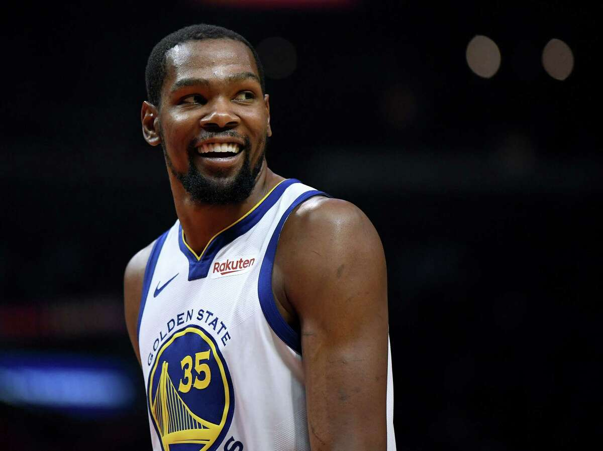 FILE - JUNE 30, 2019: It was reported that Kevin Durant of the Golden State Warriors is planning to sign with the Brooklyn Nets June 30, 2019. LOS ANGELES, CALIFORNIA - APRIL 26: Kevin Durant #35 of the Golden State Warriors smiles at his bench in a 129-110 win over the LA Clippers during Game Six of Round One of the 2019 NBA Playoffs at Staples Center on April 26, 2019 in Los Angeles, California. (Photo by Harry How/Getty Images) NOTE TO USER: User expressly acknowledges and agrees that, by downloading and or using this photograph, User is consenting to the terms and conditions of the Getty Images License Agreement.