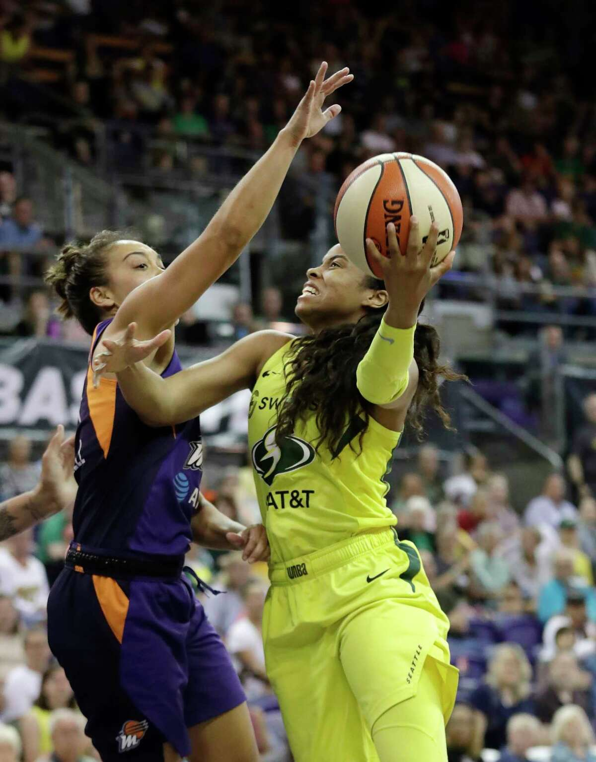 Seattle Storm's Jordin Canada, right, shoots as Phoenix Mercury's Leilani Mitchell defends in the second half of a WNBA basketball game Sunday, June 30, 2019, in Seattle. (AP Photo/Elaine Thompson)