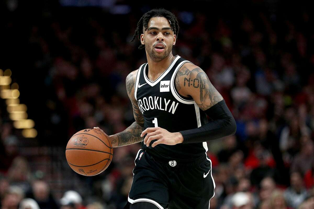 PORTLAND, OR - MARCH 25: D'Angelo Russell #1 of the Brooklyn Nets dribbles down the court against the Portland Trail Blazers during their game at Moda Center on March 25, 2019 in Portland, Oregon. NOTE TO USER: User expressly acknowledges and agrees that, by downloading and or using this photograph, User is consenting to the terms and conditions of the Getty Images License Agreement. (Photo by Abbie Parr/Getty Images)