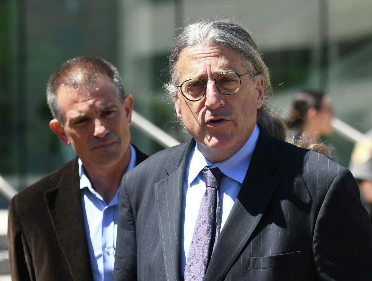 Fotis Dulos, left, is accompanied by his attorney Norm Pattis, after making an appearance at Connecticut Superior Court in Stamford, Conn. Wednesday, June 26, 2019.