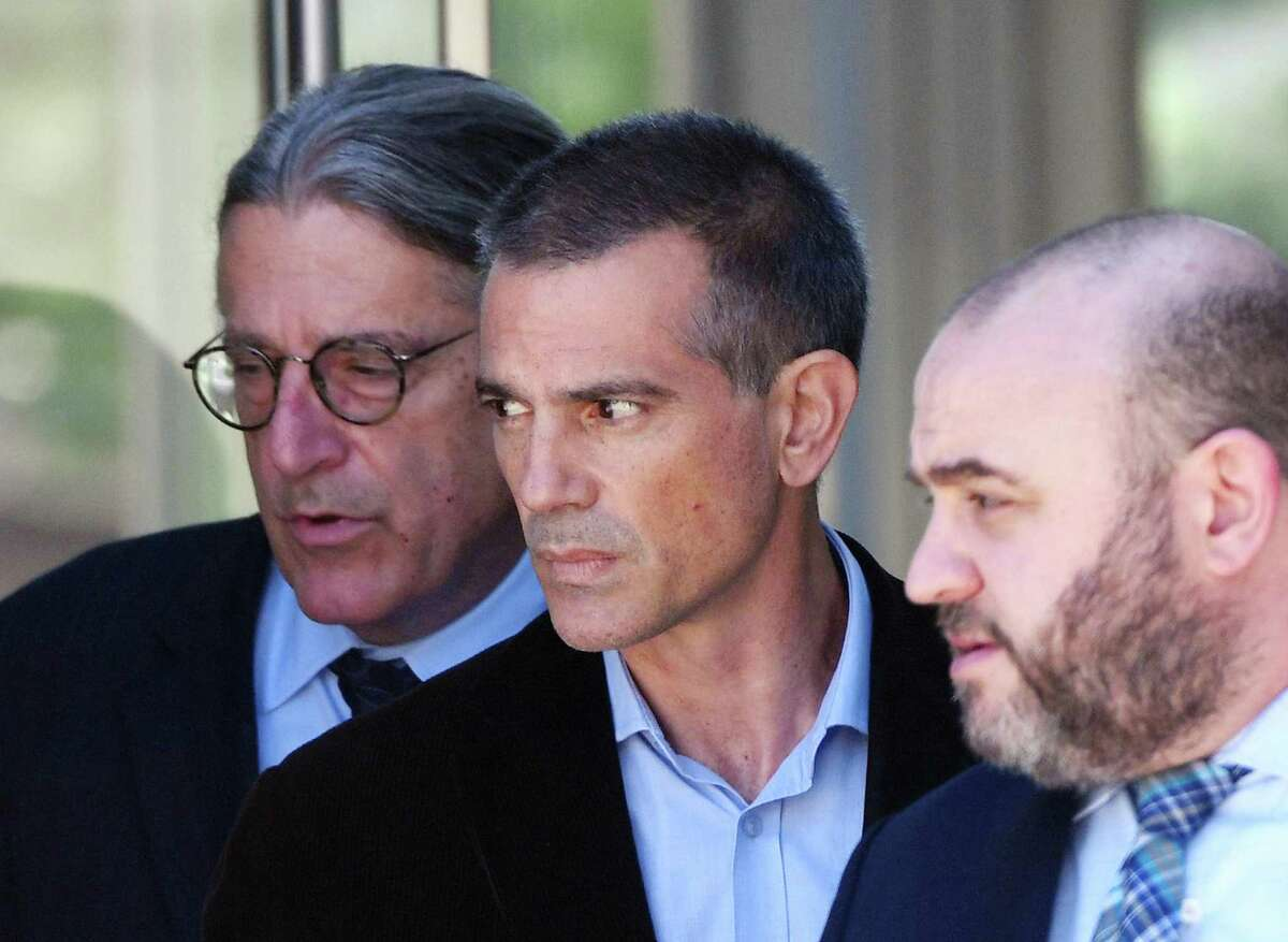 Fotis Dulos, center, is accompanied by his attorneys Norm Pattis, left, and Rich Rochlin after making an appearance at Connecticut Superior Court in Stamford, Conn. Wednesday, June 26, 2019.