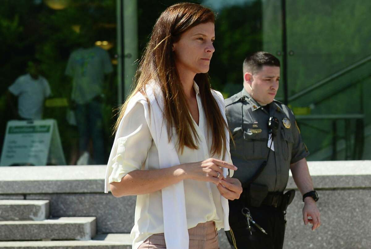 Michelle Troconis exits the courthouse after attending her hearing on Friday, June 28, 2019.
