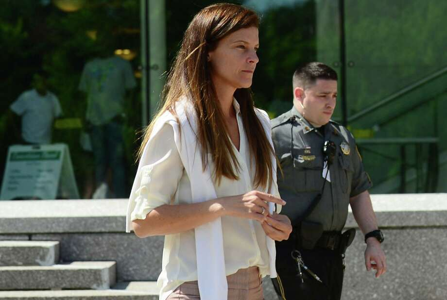Michelle Troconis exits the courthouse after attending her hearing on Friday, June 28, 2019. Photo: Erik Trautmann / Hearst Connecticut Media / Norwalk Hour