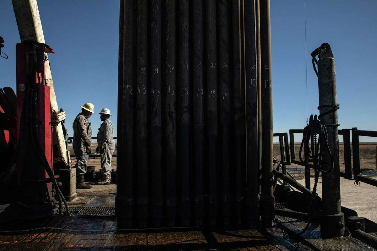 Workers at an oil drilling rig on a Parsley Energy facility near Midland, Texas, on Jan. 24, 2019.