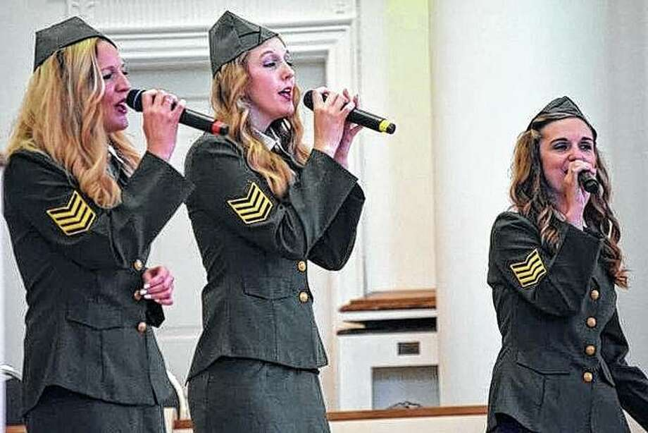 The Gibson Girls, a music group from Jerseyville, performs Sunday during the God and Country service in MacMurray College's Annie Merner Chapel. The program honored veterans and first responders for their service