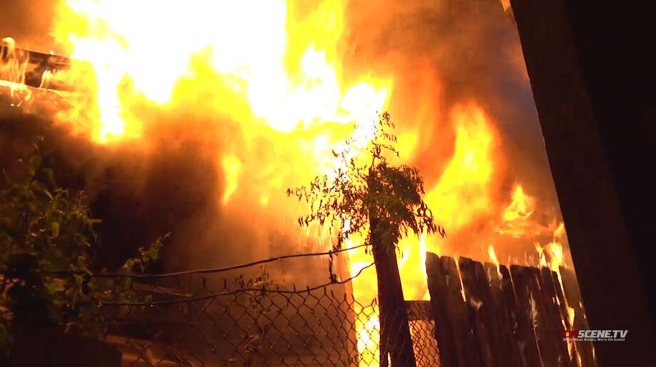 Houston firefighters extinguish a blaze early Monday, July 1, at a home in the 700 block of Gregg Street. The sole resident escaped with no injuries. Photo: OnScene TV