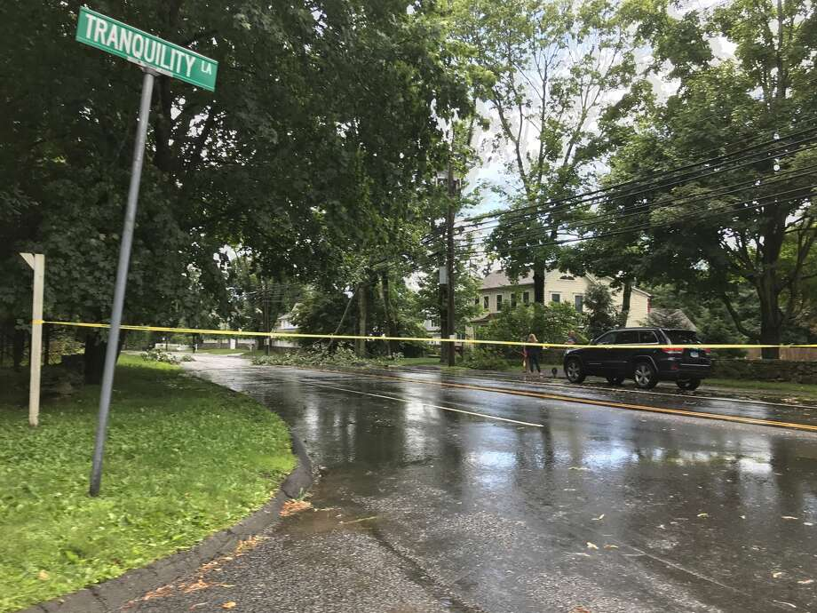 Compo Road in Westport is shut after a tree fell on power lines during a brief storm on Sunday, June 30, 2019. Photo: Jordan Fenster/Hearst Connecticut Media