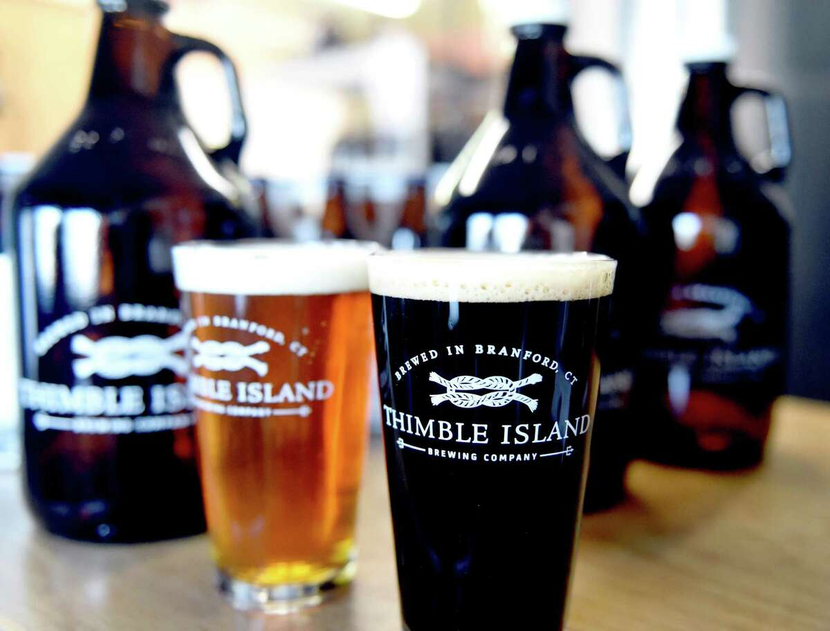 """Type: American Porter Availability: Online order, in stores and on tap Blending the signature taste of pumpkin with an American-style porter, Thimble Island describes the Dark Pumpkin Porter as a """"malty"""" and """"robust"""" fall favorite."""