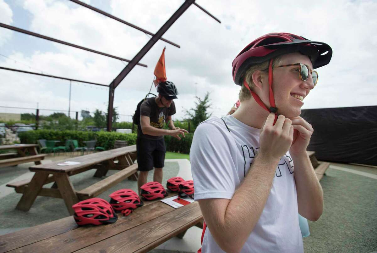 Paul Kieffer puts on his bicycle helmet as his and his co-workers are about to start the Tour de Brewery's Downtown and Eado Tour from Saint Arnold Brewing Company on Saturday, June 22, 2019, in Houston. The four-hour bicycle tour started from Saint Arnold Brewing Company, to Sigma Brewing Company and 8th Wonder Brewery, then go back to Sant Arnold Brewing Company.