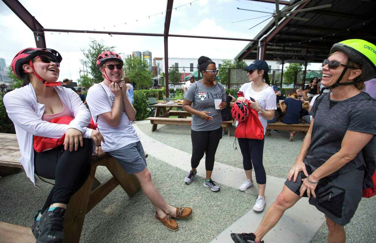 After drinking some beer and hanging out for a little, co-workers Claudia Gamica, from left, Paul Kieffer, Alexis Désiré, Kaitlin Prior and Marlene Barnett small chat before taking on the Tour de Brewery's Downtown and Eado Tour from Saint Arnold Brewing Company on Saturday, June 22, 2019, in Houston. The four-hour bicycle tour started from Saint Arnold Brewing Company, to Sigma Brewing Company and 8th Wonder Brewery, then go back to Sant Arnold Brewing Company.
