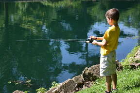 About 80 participants - young and old - took part in a fishing derby Saturday at Leclaire Park in Edwardsville.