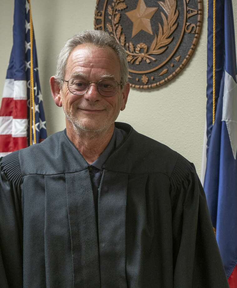 Judge David Cobos is seen beardless 07/01/19 after raising a record amount, $15,680, in a challenge with the Justices of the Peace and Constables Association of Texas scholarship fund. Cobos made the challenge of $5000 to trim his beard, $10,000 to keep his mustache or $15,000 to get a clean shave, thinking they would never raise that amount and loose his beard of more than six years growth.  Tim Fischer/Reporter-Telegram Photo: Tim Fischer/Midland Reporter-Telegram