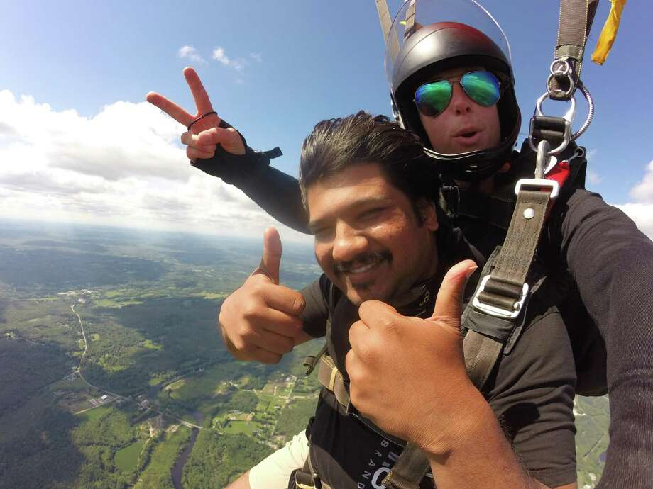 """A man takes the plunge with an instructor from Skydive Danielson, located near the Rhode Island and Massachusetts borders, has been voted """"Best Skydiving Center in the US"""" for the past three years by Blue Skies Magazine. Photo: Contributed Photo"""