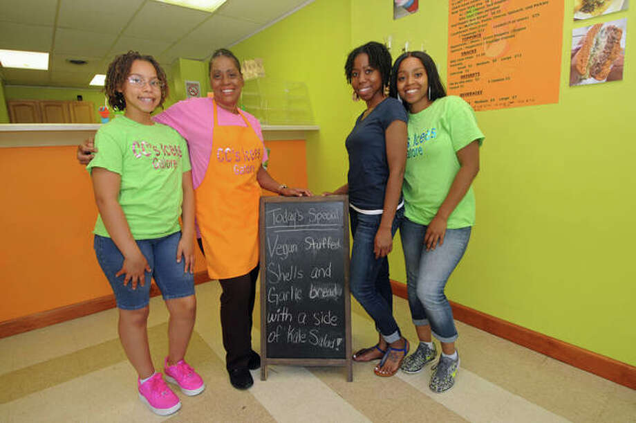 Chanel Clemons, after whom the restaurant is named, Trezel Brown, Tremina Jackson and Cherrelle Hardy are shown inside CC's Icees Galore at 1626 Main St., Alton. Along with ice treats, the restaurant features vegan dishes.