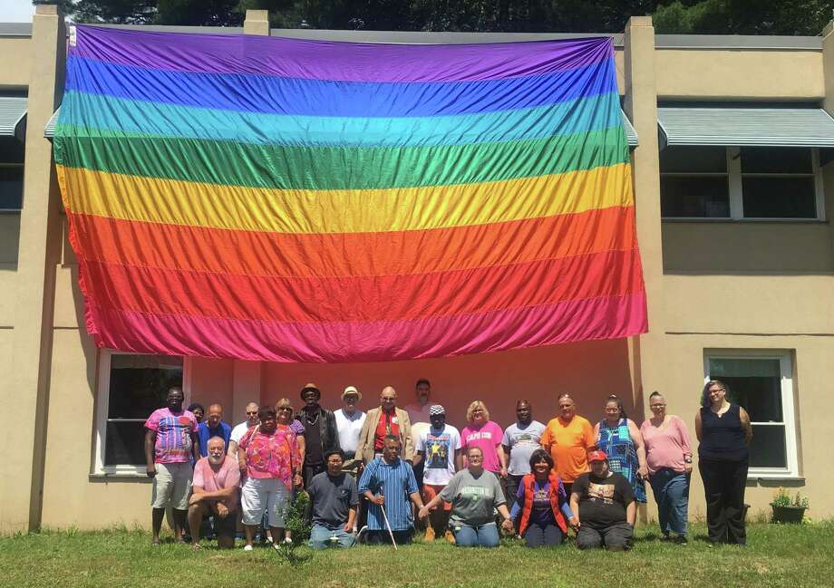 Clients, staff and friends of Gilead's Social Rehabilitation Center, at 31 DeJohn Drive in Middletown, celebrated Pride Month Friday with a giant display. Photo: Contributed Photo