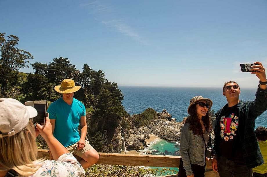 Selfies and portraits above McWay Falls, one of the most popular photo spots in Big Sur. Photo: Nic Coury / Special To The Chronicle