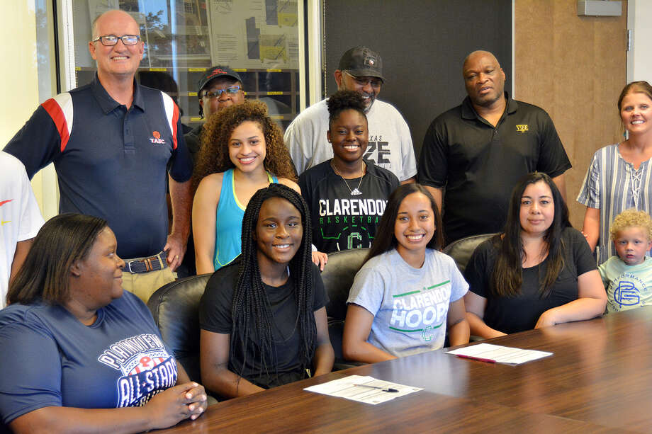 Recent Plainview graduates Jaclynn Black and Olivia Shannon were joined by friends, family and their former coaches as they signed their letters of intent to continue their basketball careers at Clarendon College in a special ceremony on Thursday at Plainview High School. Photo: Nathan Giese/Planview Herald