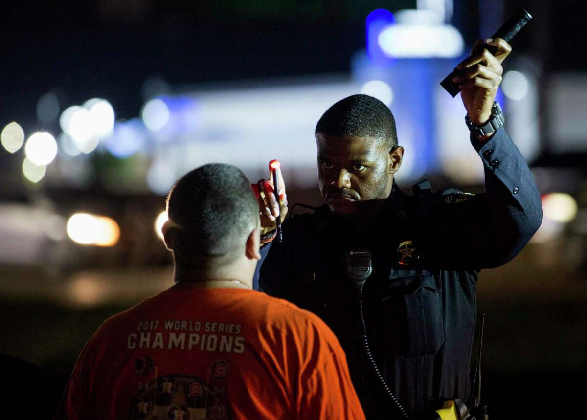 Harris County Precinct 8 deputy constable Jonathan Toliver administers a field sobriety test on the frontage road along Interstate 45 south of downtown Houston on Sept. 1, 2018.