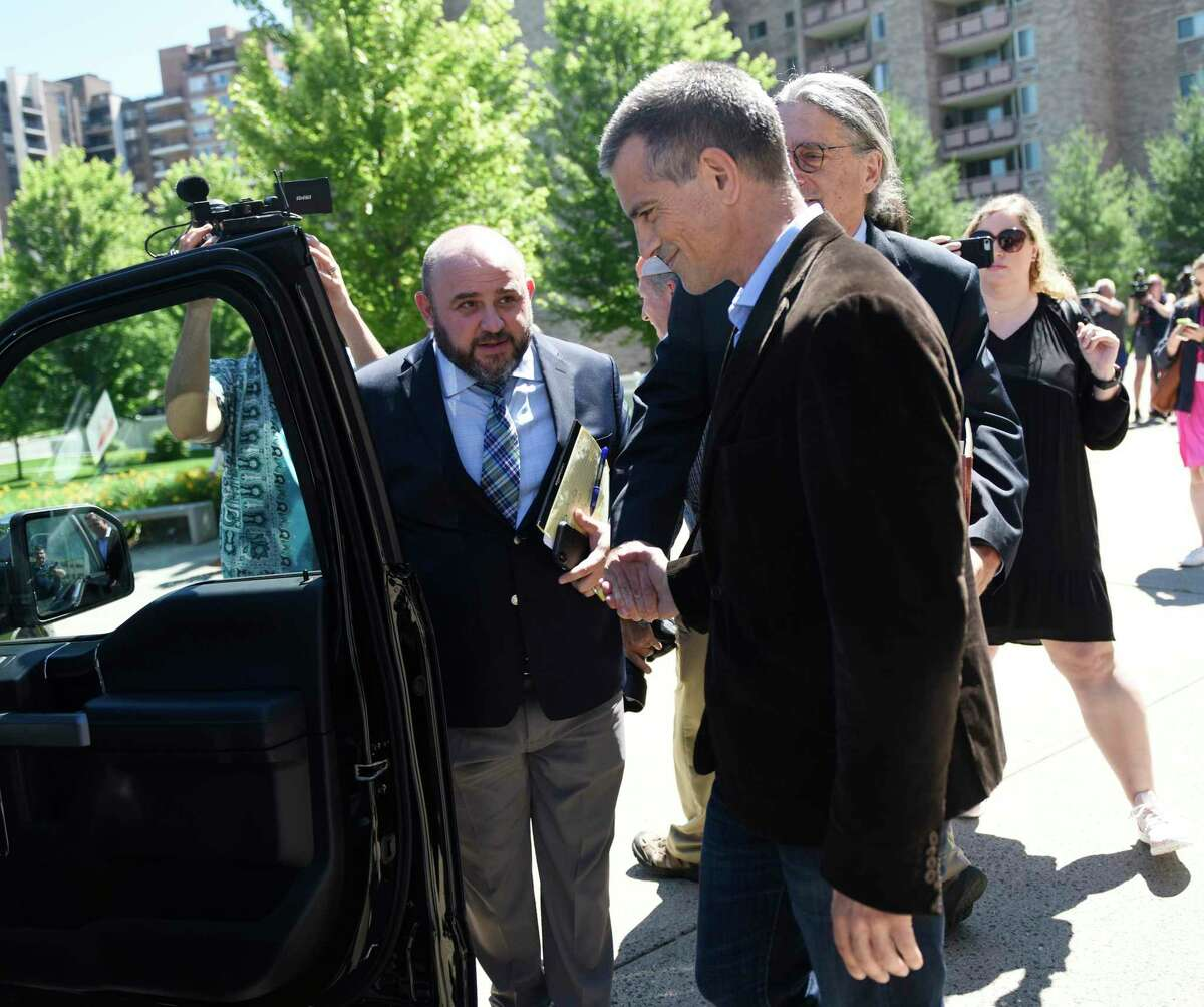 Fotis Dulos exits after making an appearance at Connecticut Superior Court in Stamford, Conn. Wednesday, June 26, 2019.