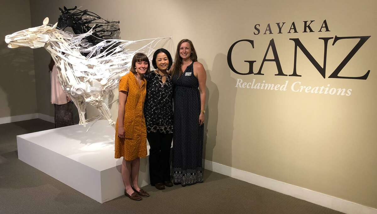 """Jen Parry, Special Events & Curatorial Assistant for Stamford Museum & Nature Center, left; Sayaka Ganz, exhibition artist; and Jillian Casey, Curator of Collections & Exhibitions for SM&NC, at the opening of """"Reclaimed Creations."""""""