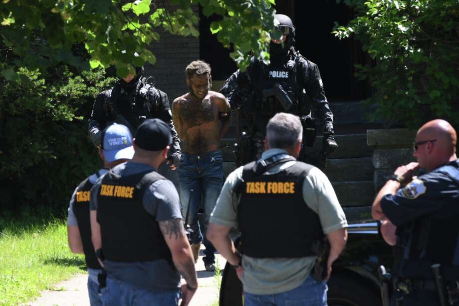 Police remove a suspect after a standoff in Schenectady's Vale neighborhood. Photo: Will Waldron, Times Union