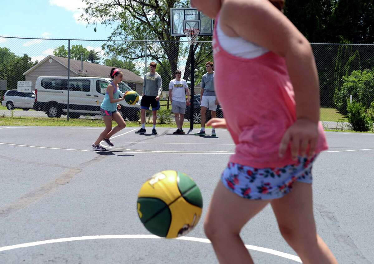 Children do basketball drills with members of Siena College Men's basketball team on Monday, July 1, 2019, at CAPTAIN Community Human Services in Clifton Park, N.Y. (Catherine Rafferty/Times Union)