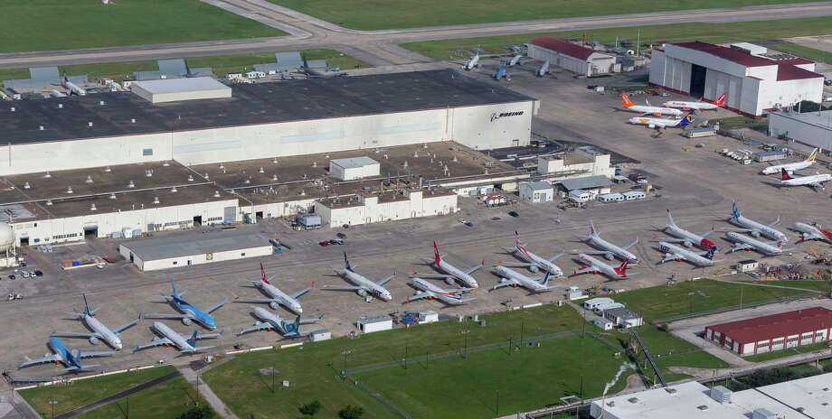 Newly built Boeing 737 Max aircraft are seen in an aerial image Saturday, June 29, 2019 at Boeing's Kelly Field maintenance facility in San Antonio. Ballooning inventory at the company's Seattle plant caused the continued manufacture of the aircraft even as the fleet is grounded world-wide following two crashes has created a storage headache for the aerospace company. At least 44 of the currently undeliverable planes painted in markings for airlines from around the world were seen Saturday. Photo: William Luther, Staff Photographer / ©2019 San Antonio Express-News