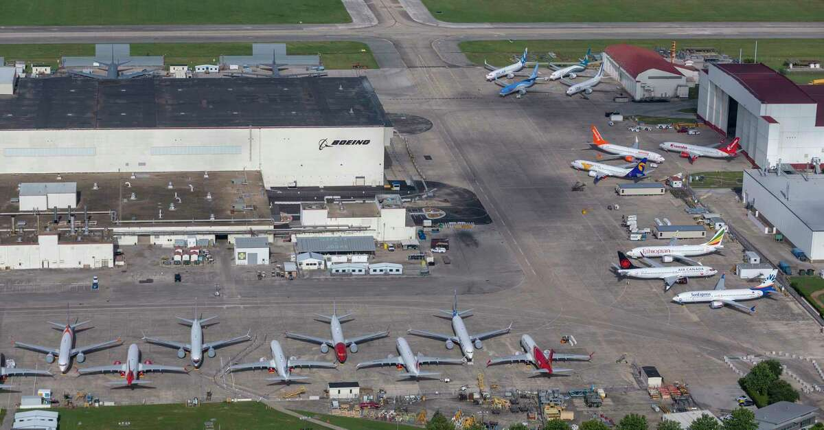 Newly built Boeing 737 Max aircraft are seen in an aerial image Saturday, June 29, 2019 at Boeing's Kelly Field maintenance facility in San Antonio. Ballooning inventory at the company's Seattle plant caused the continued manufacture of the aircraft even as the fleet is grounded world-wide following two crashes has created a storage headache for the aerospace company. At least 44 of the currently undeliverable planes painted in markings for airlines from around the world were seen Saturday.