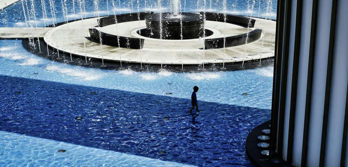 Adam Nichols, 6, of Guilderland, cools off in the fountain at the University at Albany on Monday, July 1, 2019, in Albany, N.Y. (Paul Buckowski/Times Union)