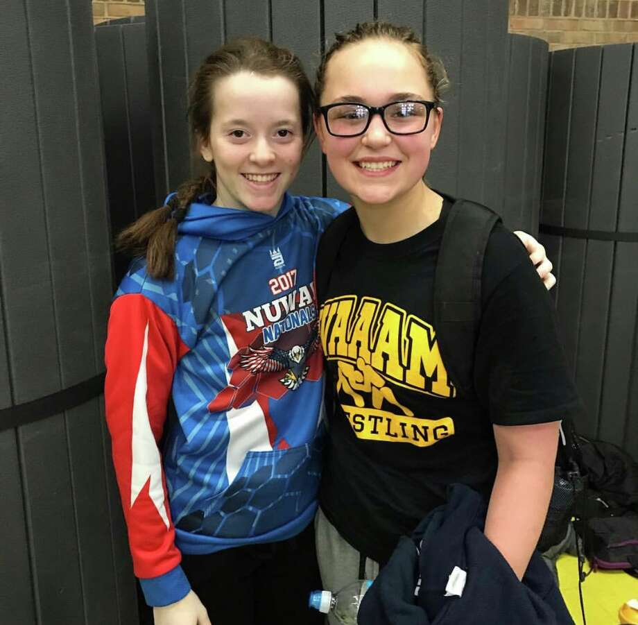 Bullock Creek's Sydney Kutzke (left) and Midland native Bella Wazny, now of Freeland, pose together during a recent break while competing with the Hemlock Lady Pitbulls club team. Photo: Photo Provided